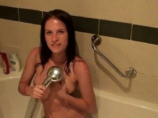 Brunette fucked in a shower